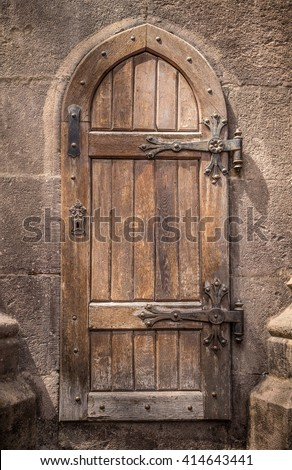 Ancient wooden door in stone castle wall #414643441 & Free photos Old wooden castle doors | Avopix.com