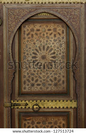 ancient wooden door with iron lock in an historical palace in Marrakesh,Morocco