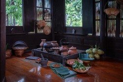 Ancient wooden old kitchen with many herbs for cooking in country house that still retain the cultural identity of old days decoration for Thai architecture traditional wooden house of Thailand