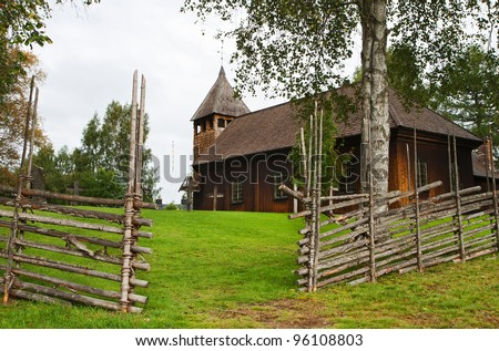 Ancient wooden Swedish church, rural landscape