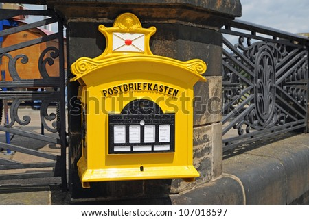 ancient yellow letterbox on a wall in germany