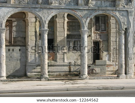 And old building being rebuilt in Malecon (sea drive) in Havana City, Cuba