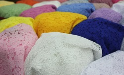And the colorfullace in Fabric shop at Wararos Market, Chiangmai.  Colorful lace background.