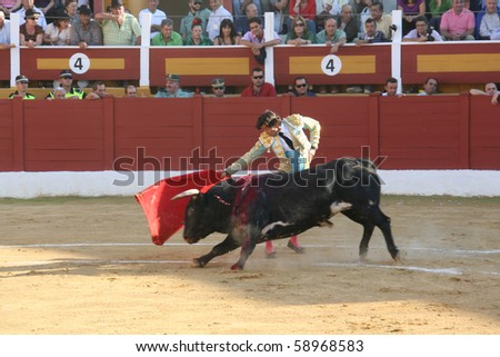 "ANDALUCIA - OCTOBER 17: ""Corrida"" (bullfight) of bulls, typical Spanish tradition where a torero (bullfighter) kills a bull. In the picture, ""Curro Diaz"". October 17, 2010 in Andalucia (Spain) - stock photo"