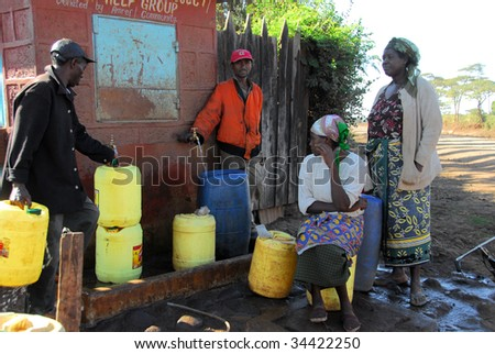 ANDES MTITO, KENYA - JULY 13 : Local people stock water July 13, 2009 in Andes Mtito. Various humanitarian organizations have contributed in order to supply fresh water for local people here.