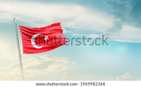 Andorra national flag waving in beautiful sky.