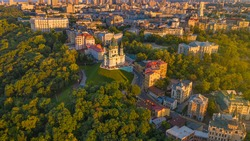 Andriyivskyy Descent and St Andrew's Churchin Kyiv ( Kiev ) city the capital of Ukraine in eastern europe. Beautiful sunset light on historical hills. Top aerial drone panoramic view from above.
