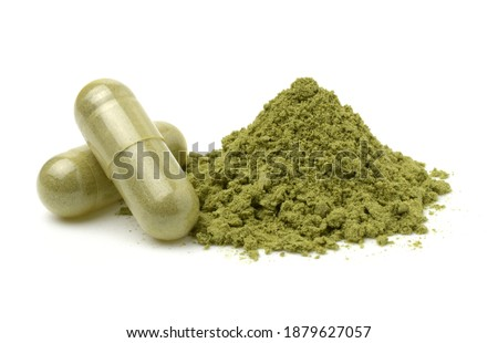 Andrographis Paniculata powder and capsules (Herbal capsules) isolated on a white background,cutout. Stockfoto ©