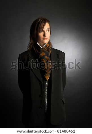 Androgyne. Portrait of young woman in men's suit.