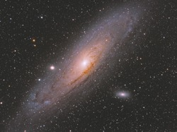 Andromeda galaxy also known as Messier 31 in Andromeda constellation, with many stars as background in the deep space.