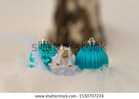 angel and christmas balls in snow with bokeh background; christmas card with copy space #1530707234