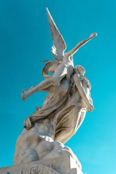 ANGEL ASCENDING WITH WOMAN FUNERARY MONUMENT IN POBLENOU CEMETERY, BARCELONA