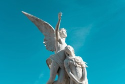 ANGEL ASCENDING WITH WOMAN, FUNERARY MONUMENT IN POBLENOU CEMETERY, BARCELONA