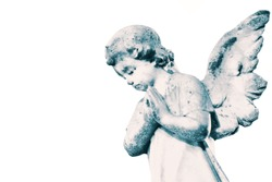 Angel cherub stone statue memorial grave headstone isolated on a white background.  With colour toning