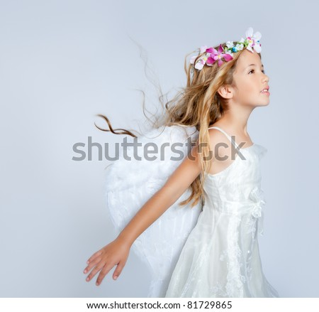 Angel child girl with wind in hair