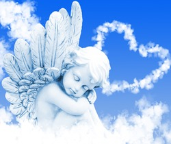 Angel dreams before heart from clouds