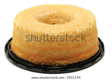 Angel food cake on black plate; white background