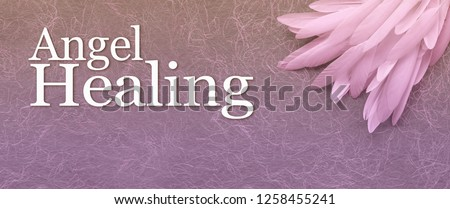 Angel Healing Banner Head - a neat pile of long thin white feather in the right corner beside the words ANGEL HEALING on a fibrous gold and purple hand made  paper background with copy space