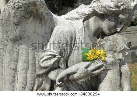 angel holding a child, antique sculpture on Monumental Cemetery of Staglieno, Genoa,Italy, Europe