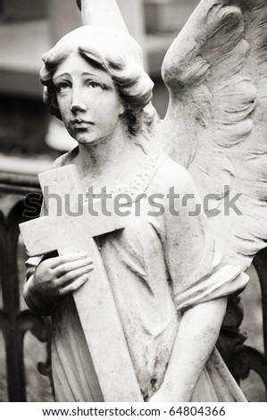 Angel holding Cross - stock photo