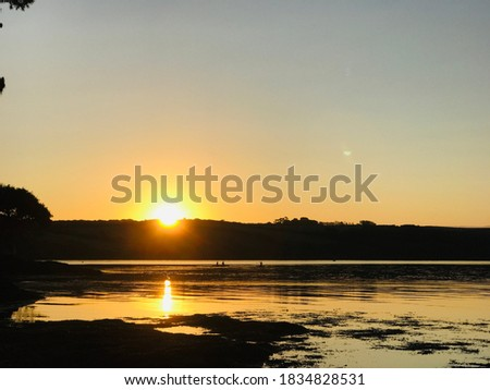 Angel light sunrise from Loe Beach in the Fal Estuary in Cornwall. This most southerly county of the UK, with a proud maritime heritage, is a popular holiday destination. Stock fotó ©