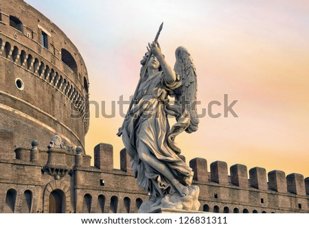 Angel on guard of Rome, statue of an angel on the background Castle Sant'Angelo, Rome, Italy