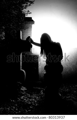 Angel on the grave - dramatic lighting - stock photo