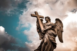 Angel over cloudy sky background, big old monument of hope, religious symbol of Christianity, Bridge of Angels, Rome, Vatican, Italy