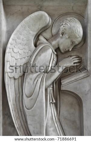 angel praying and reading