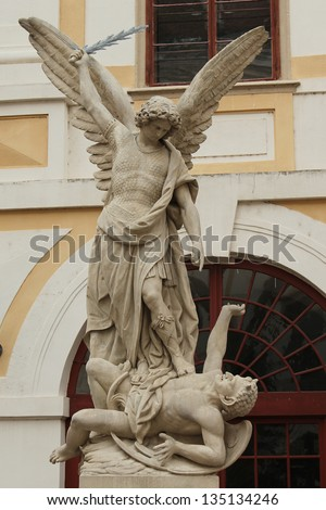 Angel Saint Michael defeats Satan. Sculpture in areal of archiepiscopal chateau in Kromeriz,(UNESCO), Czech republic. Made by F. Neumann. Contract owner archbishop Theodor Kohn.