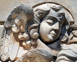 Angel sculpture in a wall from Antique Graveyard of Avola, close to the Baroque town of Noto, (Sicily).