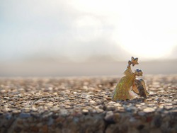 Angel shape on gravel floor in bokeh of sea .Angel and miracle. Faith in God. Pray for you. Miracle from heaven. Believe in goddess. Christianity background concept.