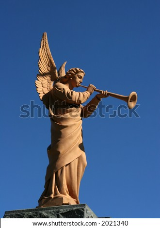 angel statue blowing horn