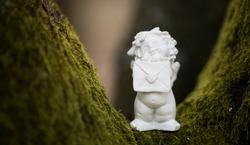 Angel statue decoration background. Forest.