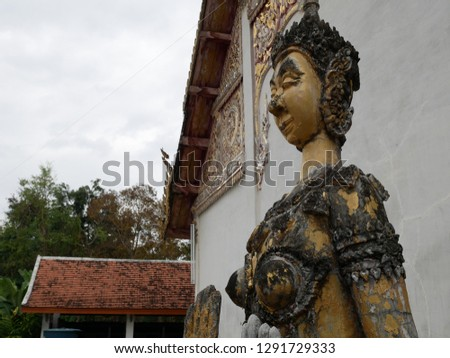 Angel statue in Phra That Chom Chaeng at Phrae Thailand. #1291729333