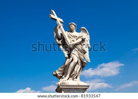 Angel statue with a cross (Sant'Angelo Bridge, Rome, Italy)