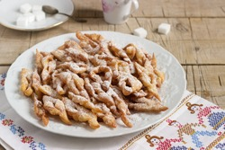 Angel wings biscuits, a traditional European sweet dish for carnival. Rustic style.