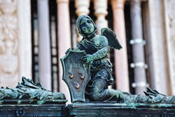 Angel with armor on the metal fence near the Cappella Colleoni (was built with marble elements between 1472 and 1476) of the Basilica di Santa Maria Maggiore (Saint Mary church). Bergamo, Italy.