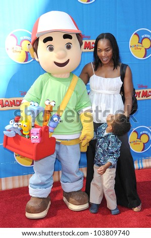 Angela Bassett and son Slater at the Los Angeles Premiere of \'Handy Manny Motorcycle Adventure\'. Arclight Hollywood, Hollywood, CA. 09-26-09