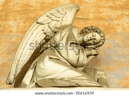 angelic figure on monumental historic cemetery in Staglieno, Genoa in Italy, Europe - stock photo