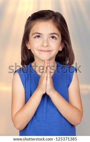Angelic little girl isolated with a ligh of background