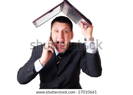 Anger businessman is screaming to the phone and is hanging his notebook on his head