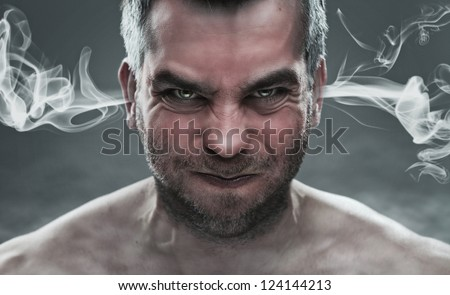 Anger, close up of angry man with smoke coming out from his ears #124144213