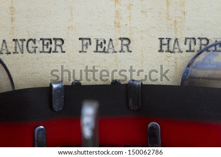 Anger hatred and fear emotion typewriten in an old paper.