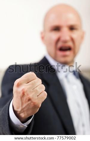 Anger screaming business men hand gesturing fist