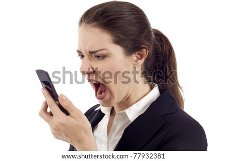 Anger - Young business woman shouting at the mobile phone isolated over white background
