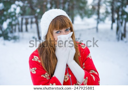 angina winter, runny nose in the winter season allergy to the cold, the flu virus in adults. girl in winter forest coughs