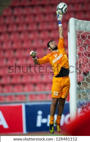 ANGKOK THAILAND-FEBRUARY06:Goalkeeper Nawaf Al-Khaldi of Kuwait in action during the football 2015 Asian Cup qualifying between Thailand and Kuwait at Rajamangala stadium on Feb 06, 2013 in,Thailand.