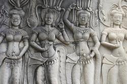Angkor Wat sculptural relief in stone carvings of dancing apsara ladies