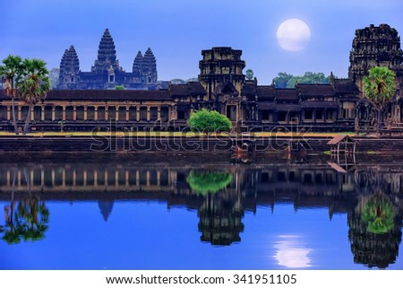 Angkor Wat Temple complex view at the main entrance, located near Siem Reap, Cambodia. Late night with the full Moon at the sky reflecting in the water #341951105